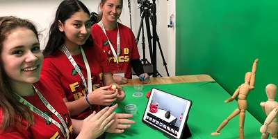 Three students at Gippsland Tech School demonstrate how augmented reality technology works on an iPad.